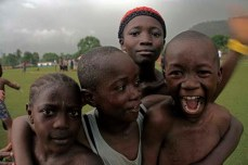 Boys play to the camera at Makeni Football stadium, Sierra Leone.