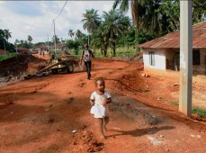 A little girl runs to the camera in Makeni, Sierra Leone.