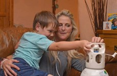 Express and Echo. Dying mum Jo Smith, sits with her son Rudey, 5, while he helps with her oxygen.